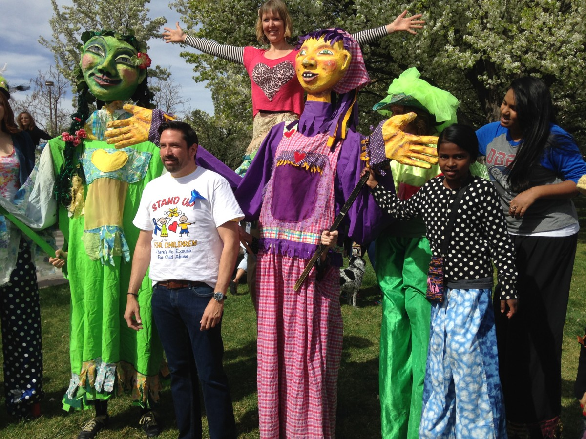 Wise Fool giant puppets with the mayor of Santa Fe.